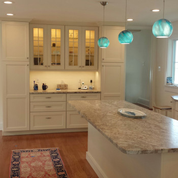 1940s residence redesign kitchen with granite island